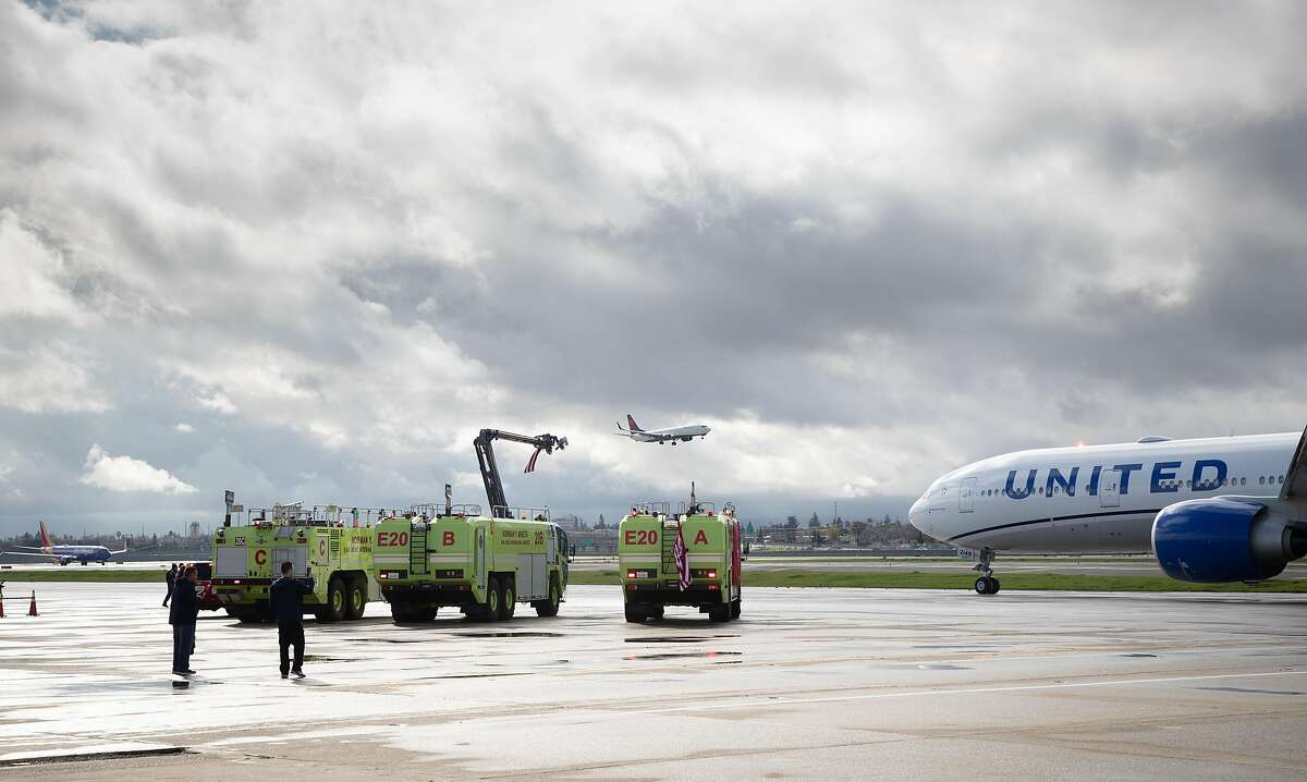 The 49ers United Airlines chartered plane taxis by fire department trucks as the San Francisco 49ers depart from Mineta San Jose International Airport Sunday, Jan. 26, 2020 in San Jose, Calif.