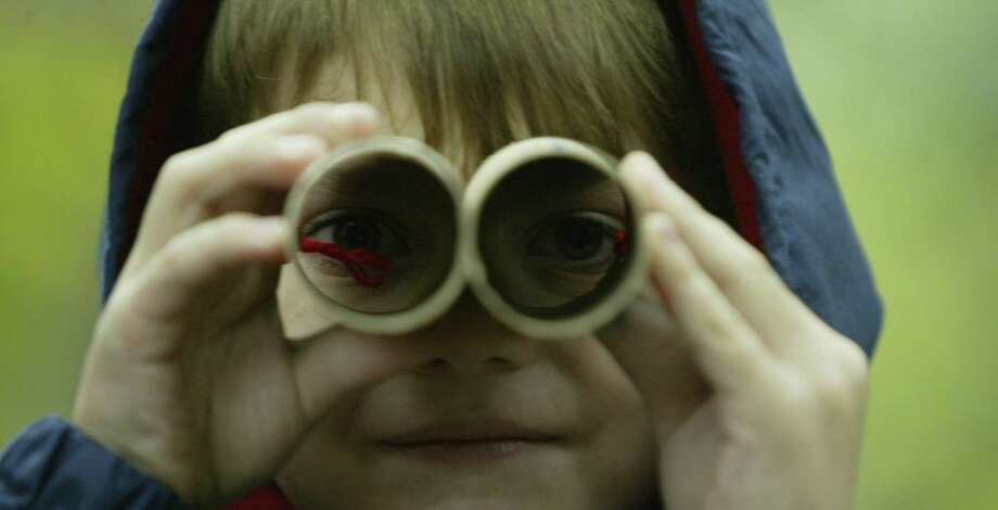 Do these homemade binoculars, made from a pair of toilet paper tubes, really work? If parents' goal is to activate their young children's imaginations, then yes. Photo: Houston Chronicle File Photo / Houston Chronicle
