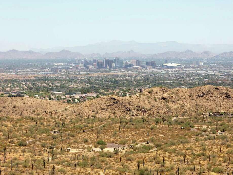 A view of Phoenix from South Mountain Park on June 18, 2020. Photo: Washington Post Photo By Cassidy Araiza / Cassidy Araiza