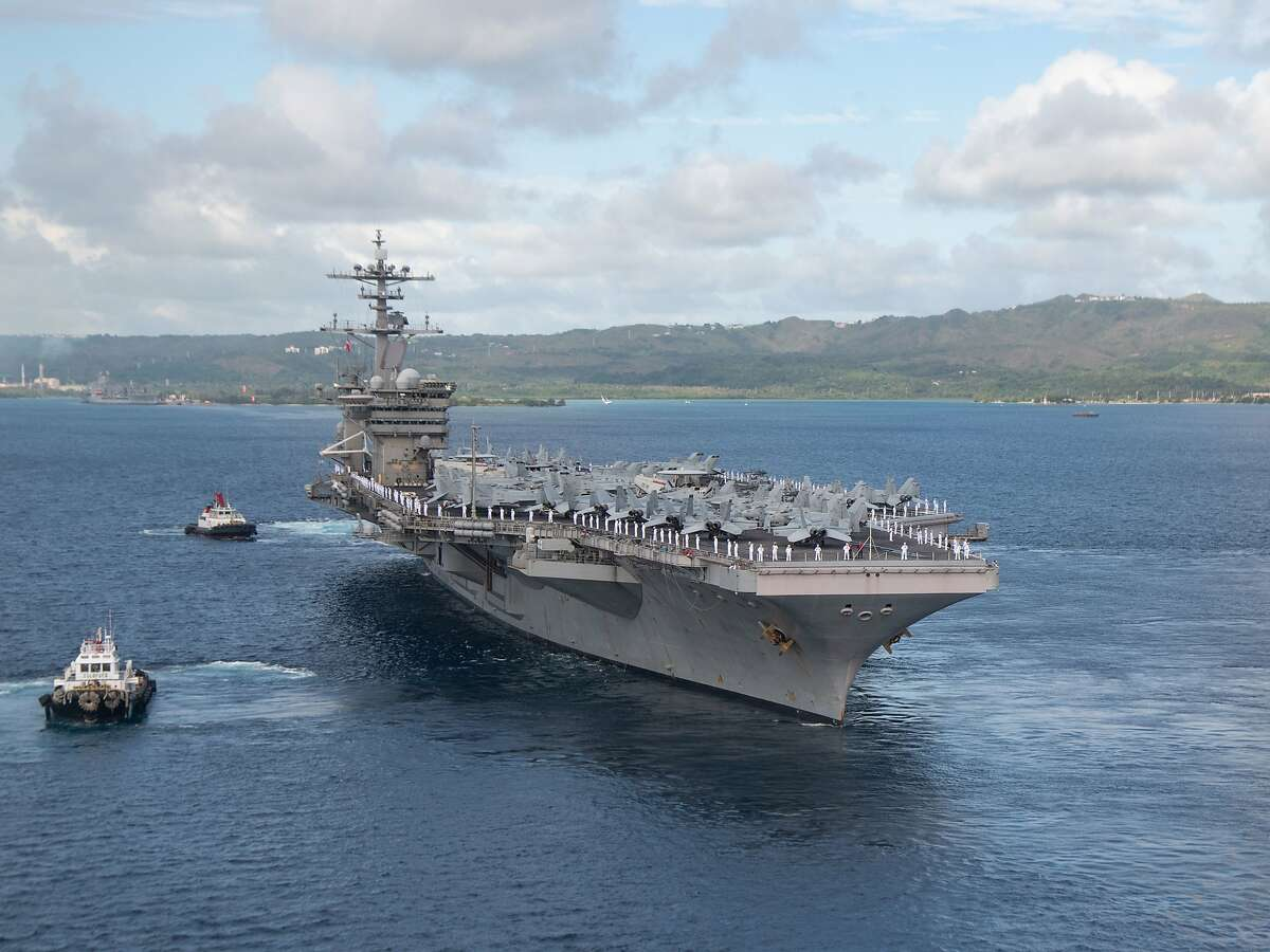200604-N-LH674-1353 NAVAL BASE GUAM (June 4, 2020) Sailors man the rails as the aircraft carrier USS Theodore Roosevelt (CVN 71) departs Apra Harbor, June 4, 2020. Following an extended visit to Guam in the midst of the COVID-19 global pandemic, Theodore Roosevelt is returning to operational tasking during a deployment to the Indo-Pacific. (U.S. Navy photo by Mass Communication Specialist Seaman Kaylianna Genier/Released)