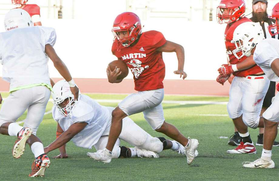 Martin High School running back Andres Salazar runs the ball as the team scrimmages against Eagle Pass High School football team on Thursday, Aug. 22, 2019, at Shirley Field. Photo: Danny Zaragoza, Staff Photographer / Laredo Morning Times