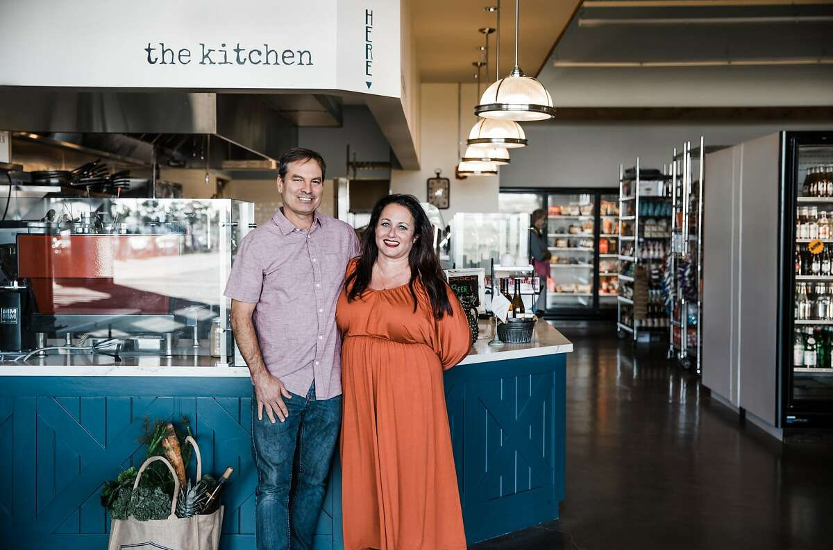 Brady Bellis and�Corinne Kinczel stand in front of the Kitchen at Rocky's Market, their new restaurant within their grocery store in Oakland's Brooklyn Basin development.