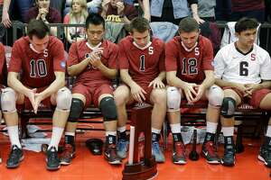 In this file photo, Stanford men's volleyball players react after losing the 2014 NCAA men's college volleyball championship. The sports program is one of 11 that the school is eliminating after the 2020-21 academic year.