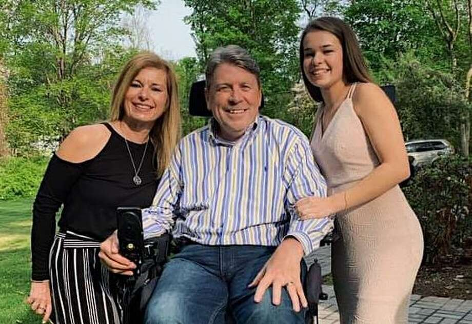 Wilton High School senior Kelsey Rhodes, right, is joined by Alison and Greg Jacobson on the occasion of her winning the Elizabeth Sternad Scholarship presented by the Wilton Woman's Club. Photo: Contributed Photo / Wilton Woman's Club / Copyright 2019. All rights reserved.