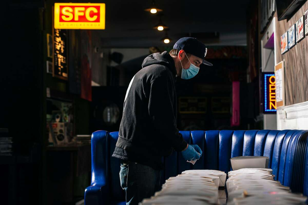 Christian Ciscle, chef-owner of SF Chickenbox, prepares to-go boxes for delivery in San Francisco, Calif. on Friday, May 15, 2020. The to-go meals are part of a partnership with SF New Deal, a non-profit formed in response to the COVID-19 pandemic where the organization provides relief to small businesses by ordering meals from restaurants and delivering them to at-risk community members in San Francisco.