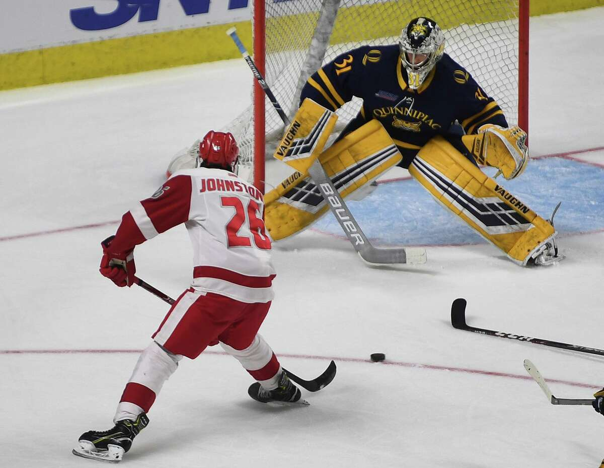 Marc Johnstone, firing a shot against Quinnipiac in the 2020 Connecticut Ice college hockey tournament, has been named captain of Sacred Heart's men's hockey team.