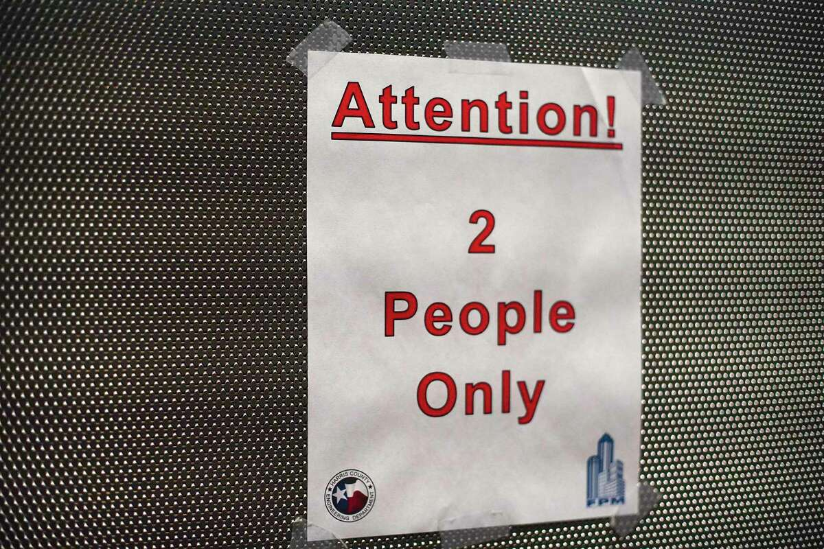 A sign in the elevator at the Harris County Courthouse on Thursday, June 11, 2020.