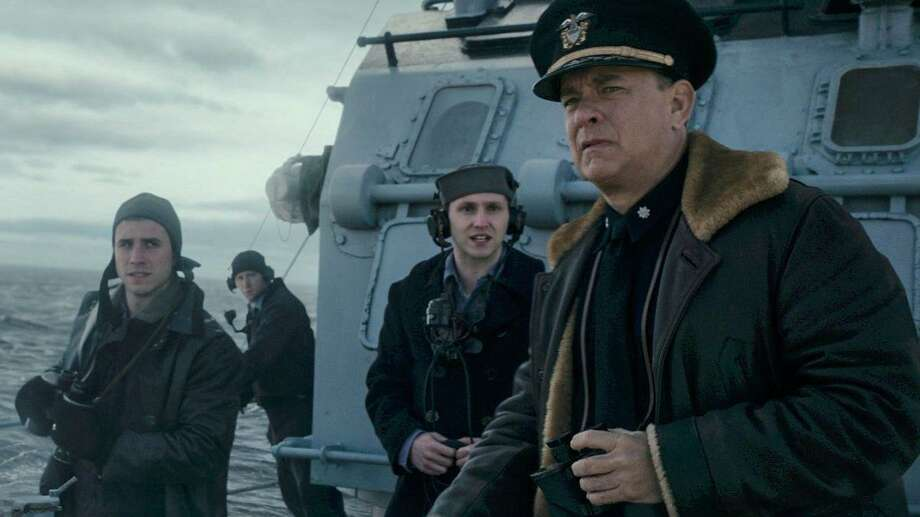 "Tom Hanks writes and stars in ""Greyhound"" a fast-paced World War II picture about a U.S. destroyer captain in charge of a large convoy of ships crossing the Atlantic under the threat of a pack of Nazi U-boats. Photo: Courtesy Photo"