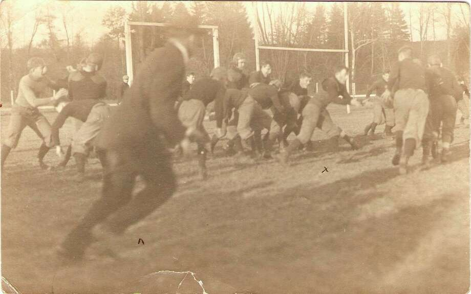 This photograph shows action from an early 1900 football game at Manistee High School.