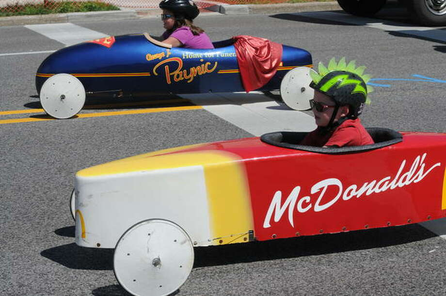 In this 2019 photo, ywo competitors in the 25th Annual Soap Box Derby on Saturday in East Alton prepare to head down Berkshire Boulevard. Race officials have called off this year's event because of the pandemic.