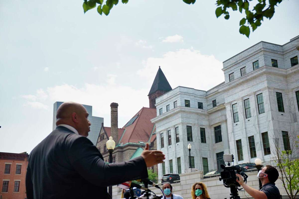 Albany County District Attorney David Soares holds a press conference to discuss the results from the Democratic primary election for Albany County District Attorney on Wednesday, July 8, 2020, in Albany, N.Y. In the background is the clock tower to Albany City Hall. Albany Mayor Kathy Sheehan endorsed Matt Toporowski, who ran against Soares. (Paul Buckowski/Times Union)