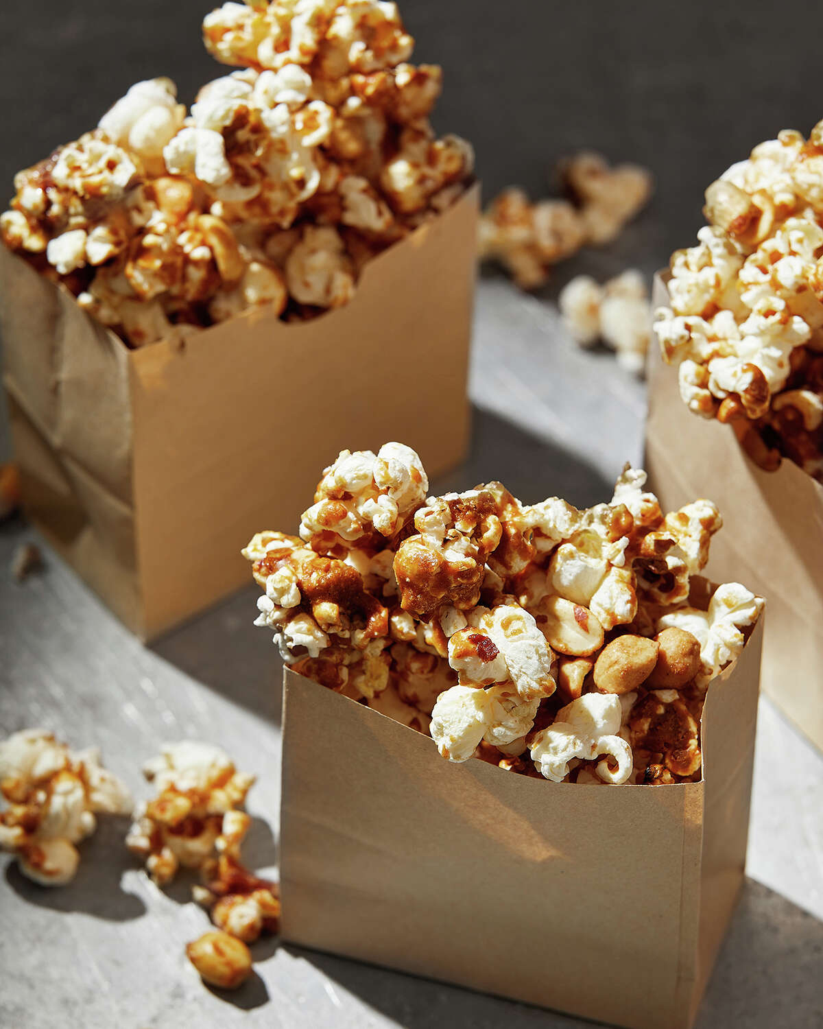 Spicy Caramel Popcorn. MUST CREDIT: Photo for The Washington Post by Tom McCorkle; food styling for The Washington Post by Lisa Cherkasky