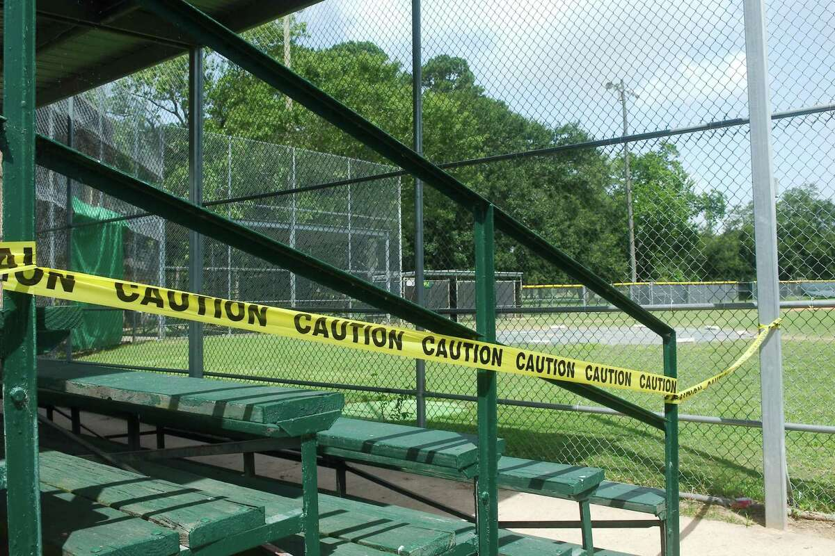 Police caution tape restricts access to the baseball field at Bay Area Park, 7500 Bay Area Blvd. Until further notice, all Precinct 2 playgrounds, splash pads, benches and sports areas such as basketball courts, soccer and softball fields and other spaces will be off limits to the public to mitigate the spread of the novel coronavirus.