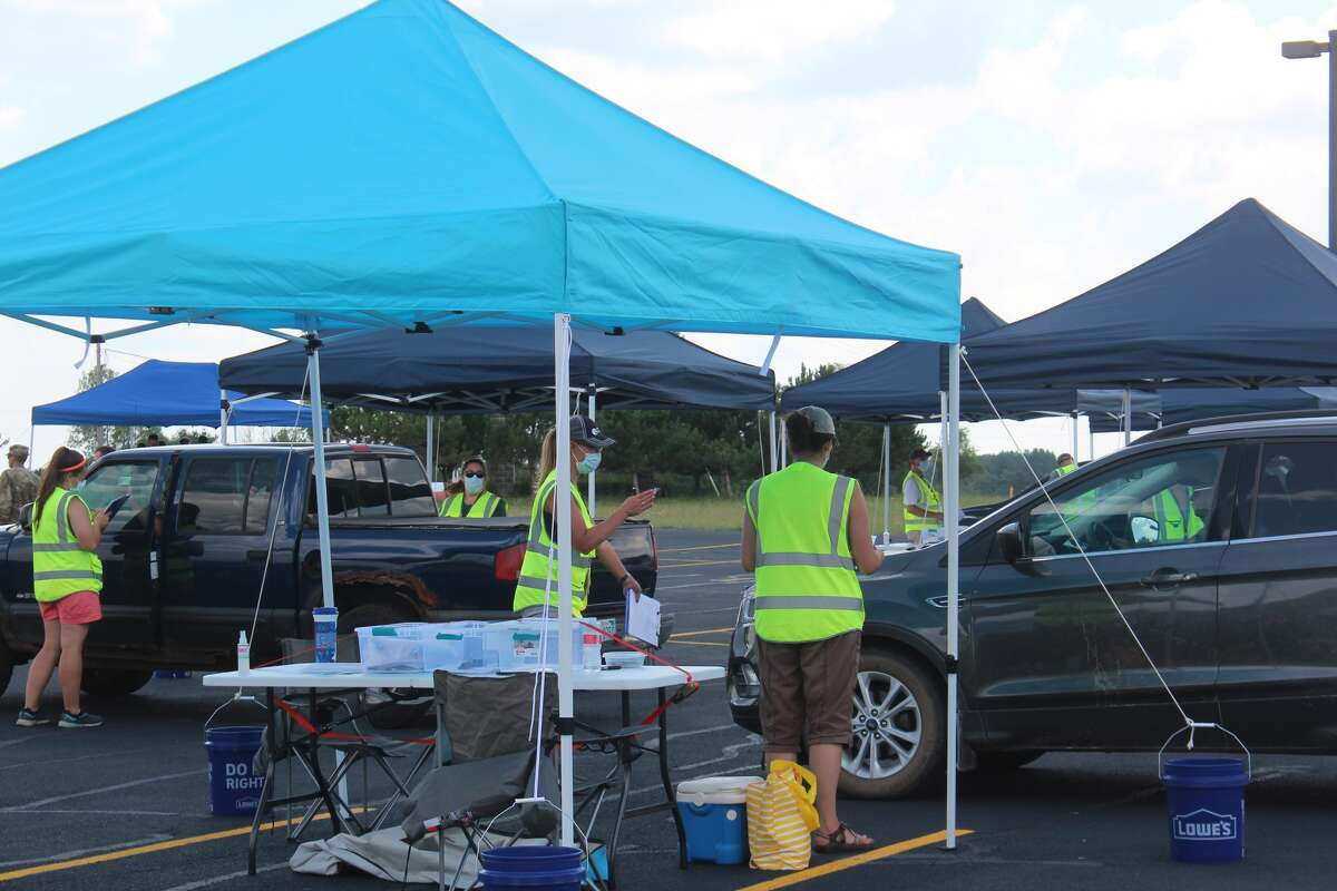 In this July 8, 2020, Pioneer file photo, workers prepare to register area residents prior to receiving free COVID-19 testing in Big Rapids.
