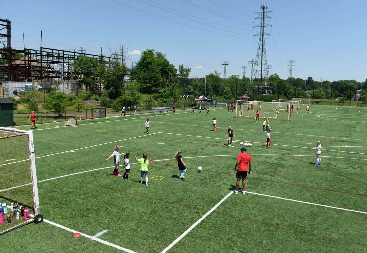 Cardinal Football Camps use the Cos Cob Park Playground in the Cos Cob section of Greenwich, Connecticut on Monday, July 6, 2020.