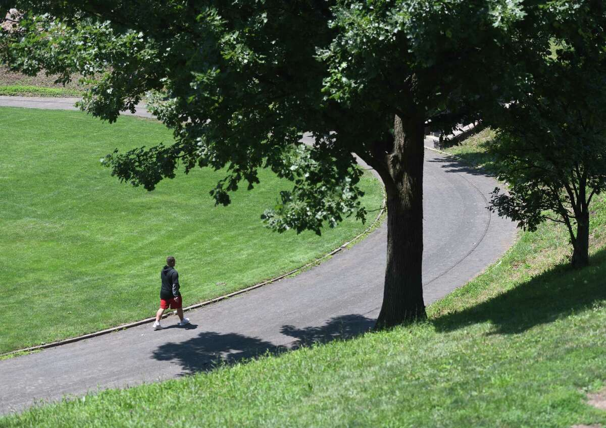 A man takes laps on the track at Havemeyer Park in Greenwich, Connecticut on Monday, July 6, 2020. The city has opened playgrounds and basketball courts for use this week after months of closure due to the coronavirus .