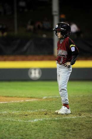 Nate Klein stands as the first base coach during Tuesday's game in the Little League World Series in Williamsport, Pennsylvania. Photo: Lindsay Niegelberg / Connecticut Post