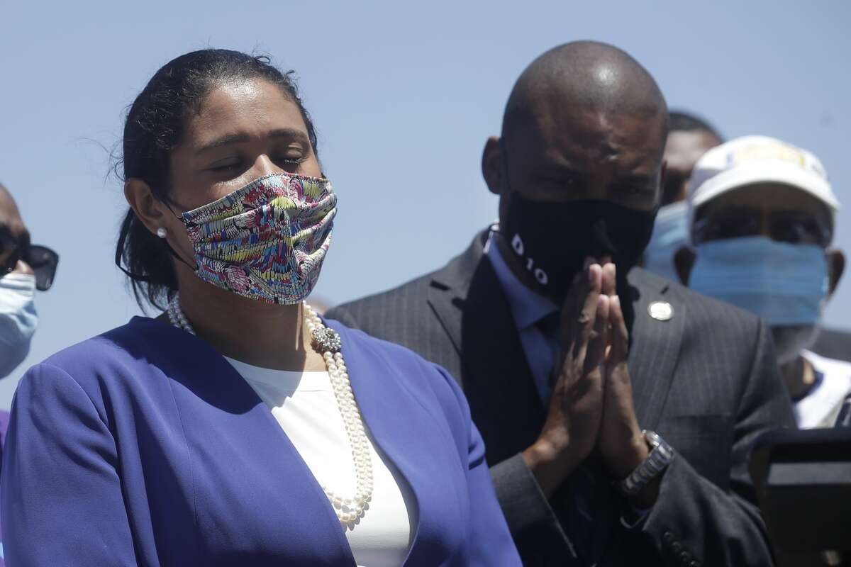 Mayor London Breed, left, and Supervisor Shamann Walton listen at a news conference about the shooting death of Jace Young in San Francisco, Tuesday, July 7, 2020.