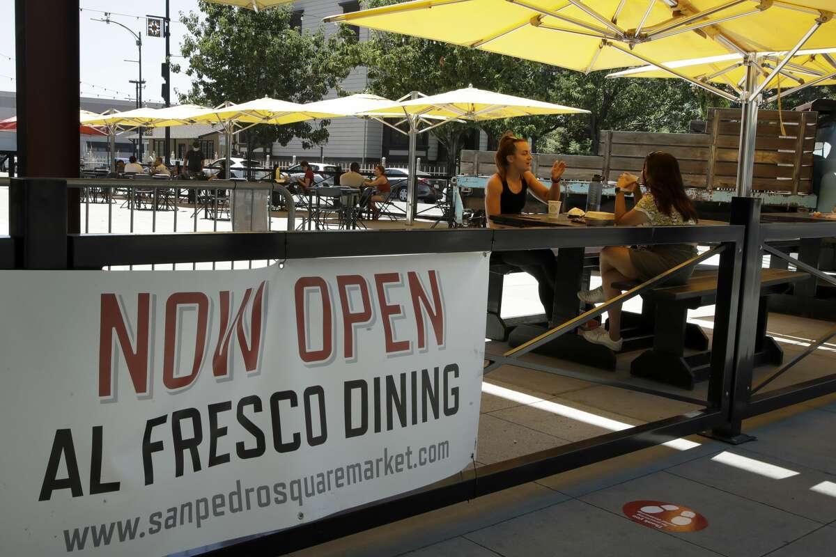 People eat outdoors at San Pedro Square on Monday, July 6, 2020, in San Jose, Calif. The Independence Day weekend saw one of Santa Clara County's largest increases in COVID-19 cases to date, which came as the state of California denied the county's application for further reopening of businesses and activities.