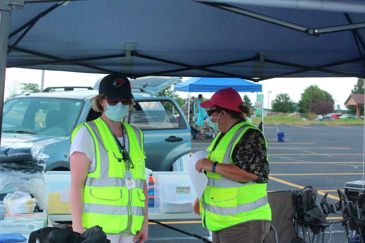 Workers with the DHD No. 10 set up tents at the Trinity Fellowship parking lot for free coronavirus testing. Testing took place from 2-7 p.m. Wednesday and Thursday. (Pioneer photo/Catherine Sweeney)