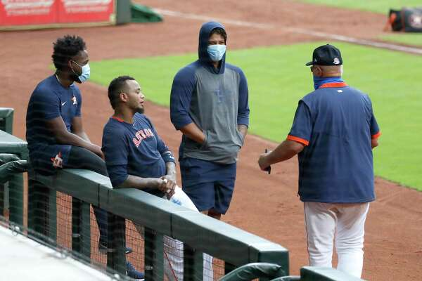 Houston Astros pitchers Chrisian Javier and Bryan Abreu and catcher Martin Maldonado talk with pitching coach Brent Strom during the Astros summer camp at Minute Maid Park, Wednesday, July 8, 2020, in Houston.