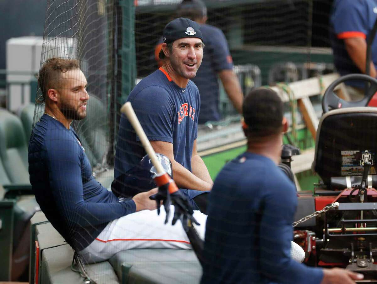 Houston Astros pitcher Justin Verlander chats with George Springer and Michael Brantley during the Astros summer camp at Minute Maid Park, Wednesday, July 8, 2020, in Houston.