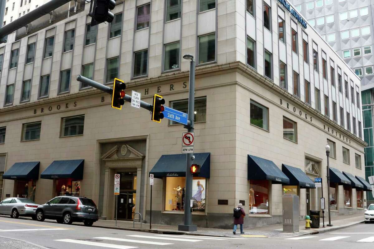 FILE - This May 6, 2020, file photo shows a Brooks Brothers store in Pittsburgh. The fashion retailer Brooks Brothers is filing for bankruptcy protection. The company that says it's put 40 U.S. presidents in its suits survived a pair of world wars and navigated through casual Fridays and a loosening of dress standards even on Wall Street, but the coronavirus pandemic pushed the 200-year-old company into seek Chapter 11 protection Wednesday, July 8, 2020. (AP Photo/Gene J. Puskar, File)