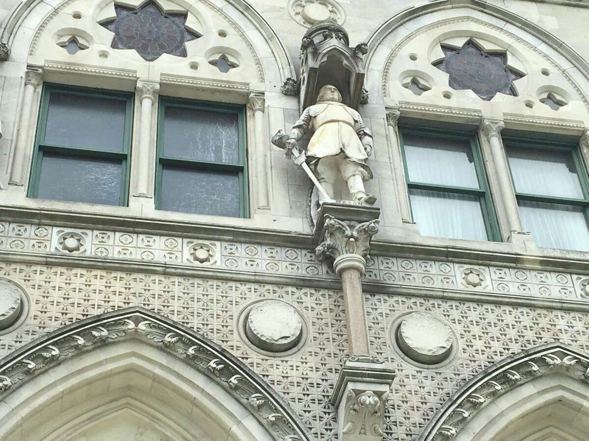 The controversial marble statue of John Mason who led state troops against the Eastern Pequot tribe in 1637, is among about two dozen historic figures immortalized around the State Capitol's exterior.
