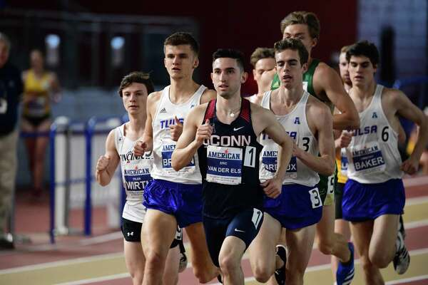Norwalk's Eric van der Els leads a pack of runners in the mile during a track and field meet. Now a UConn senior, he's disappointed 2020 will be the last season for the program, but hopes the team can go out with a bang - and maybe a Big East championship.