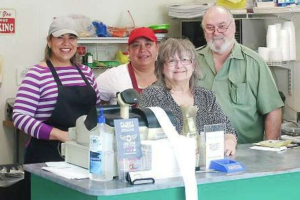 "Dixie Deli owners David and Donna Bullard, right, and employees Cece Garcia and Lulu Gallegos have been navigating the challenges of the novel coronavirus pandemic with a focus on customer service and sheer determination. ""I don't give up easily,"" David Bullard says. ""In fact, I don't think I've ever given up on anything."""