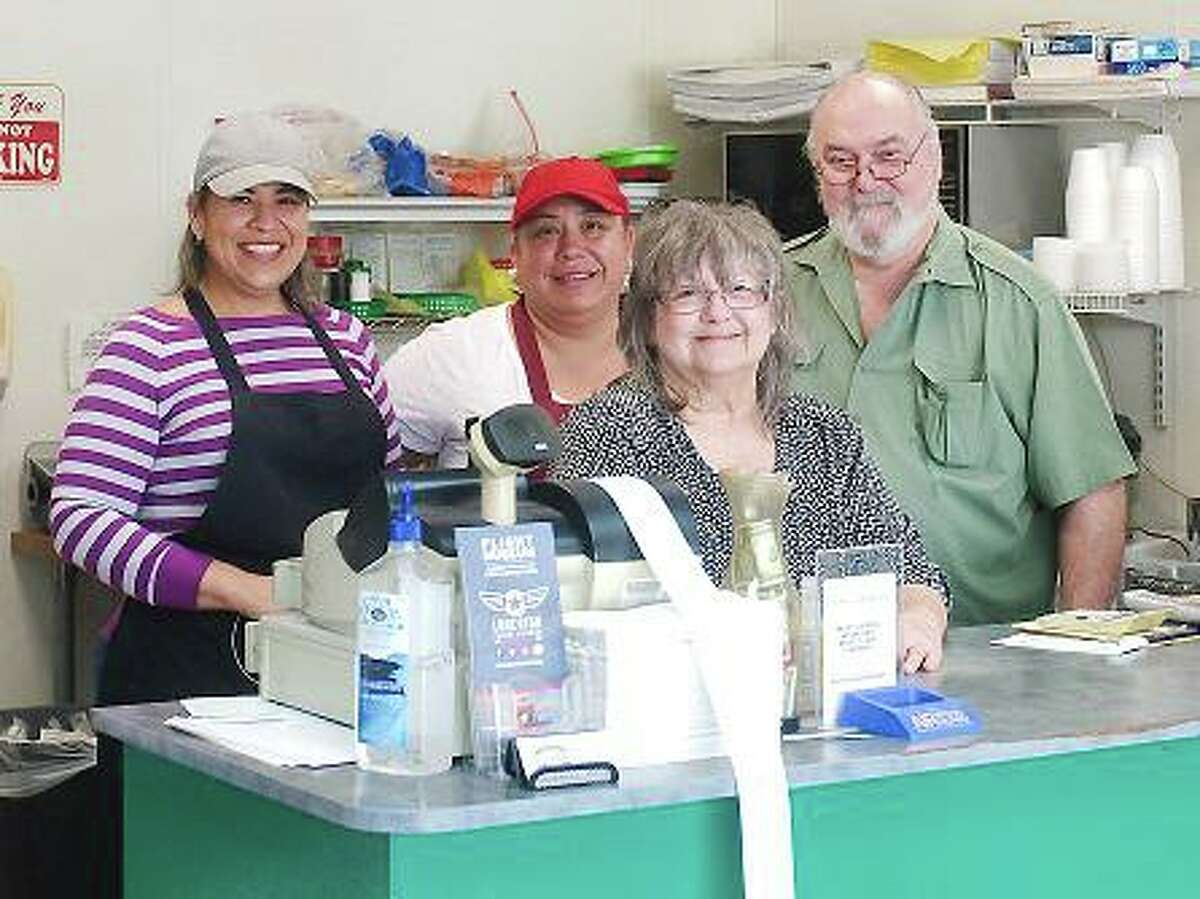 Dixie Deli owners David and Donna Bullard, right, and employees Cecy Garcia and Lulu Gallegos have been navigating the challenges of the novel coronavirus pandemic with a focus on customer service and sheer determination.