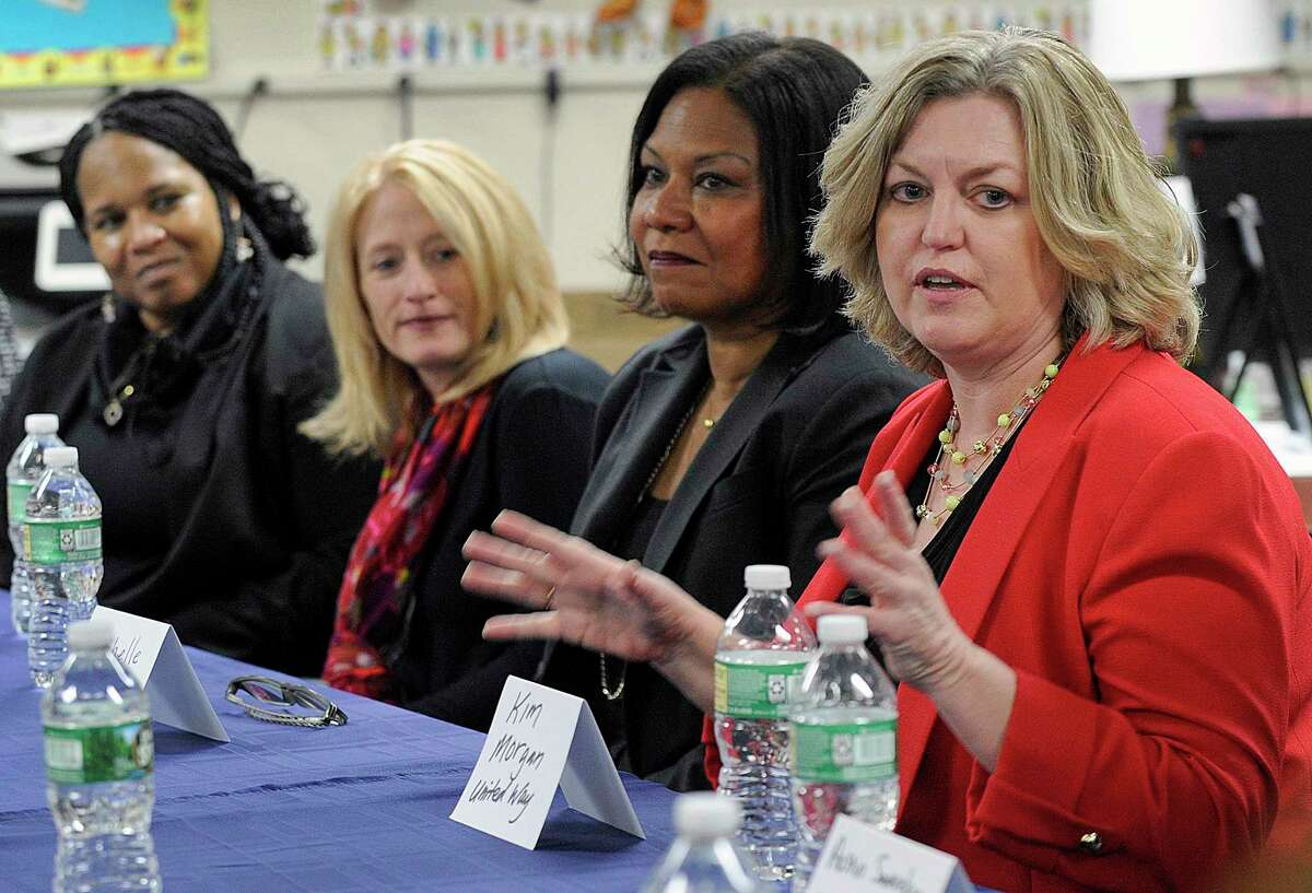 Kim Morgan, right, CEO of United Way of Western Connecticut, speaks Tuesday, Feb. 6, 2018, concerning a grant challenge that Danbury won to reduce poverty among immigrants and minorities. United Way of Western Connecticut was among the greater Danbury employers to receive a coronavirus relief check from the Small Business Administration.