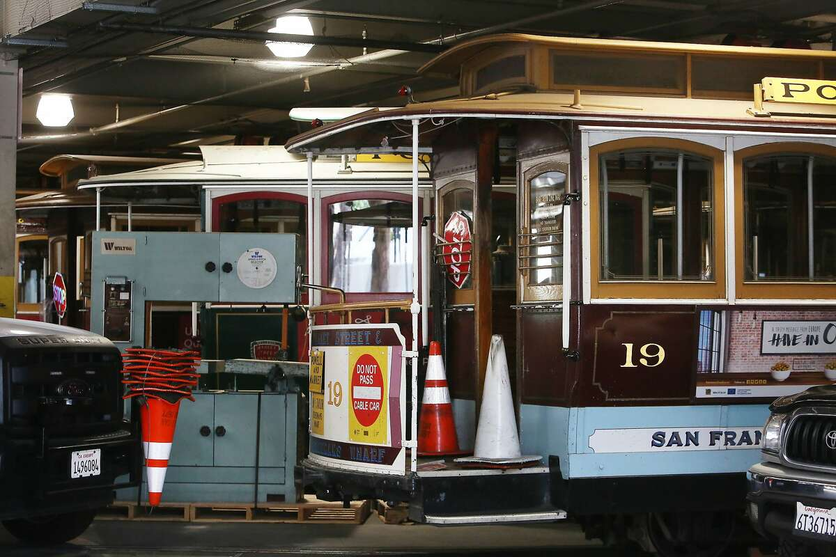 Cable cars are seen at the San Francisco Cable Car Barn & Powerhouse on Wednesday, July 8, 2020 in San Francisco, Calif.