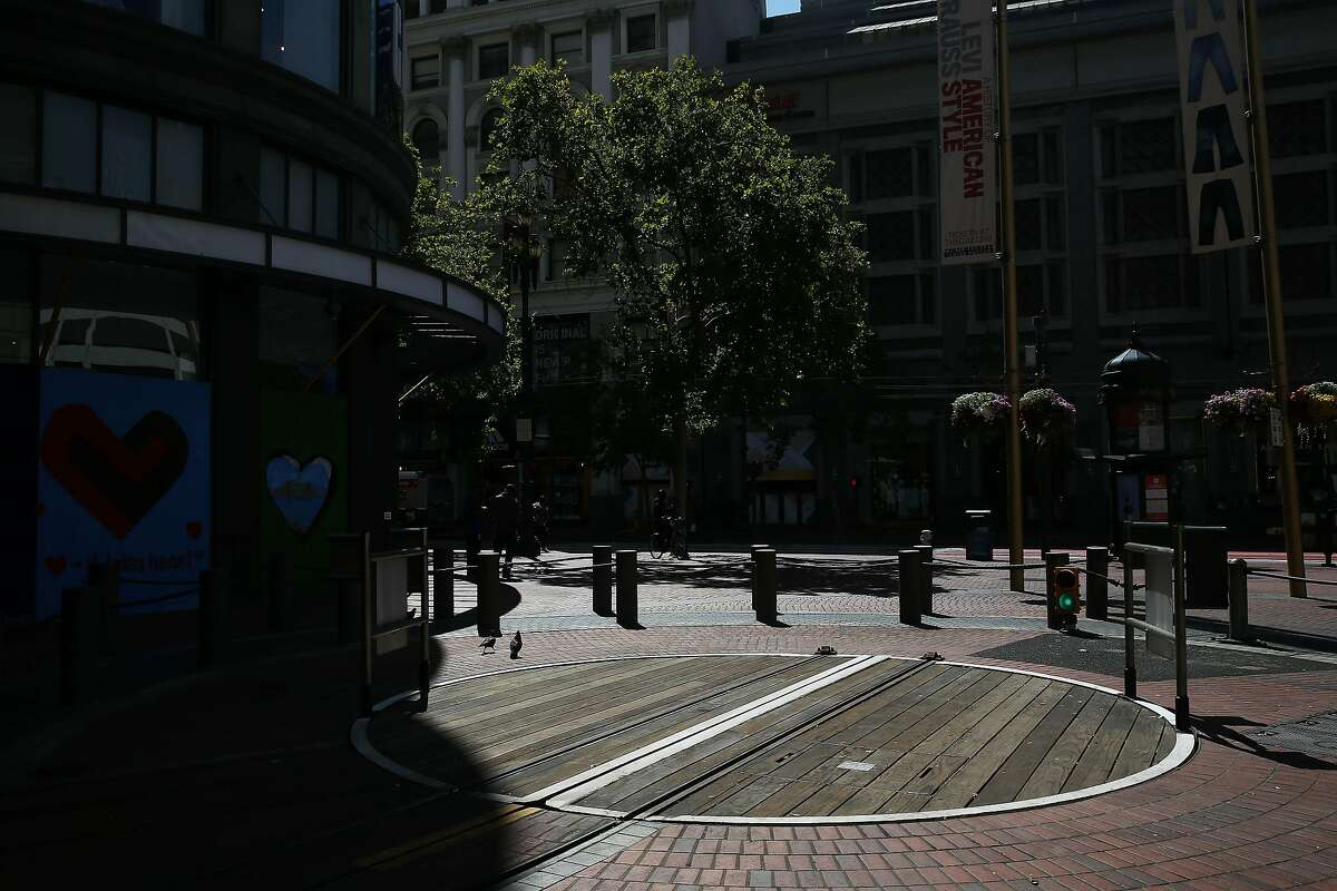 An empty cable car turnstile is seen at the Powell and Street cable car turnaround on Wednesday, July 8, 2020 in San Francisco, Calif.