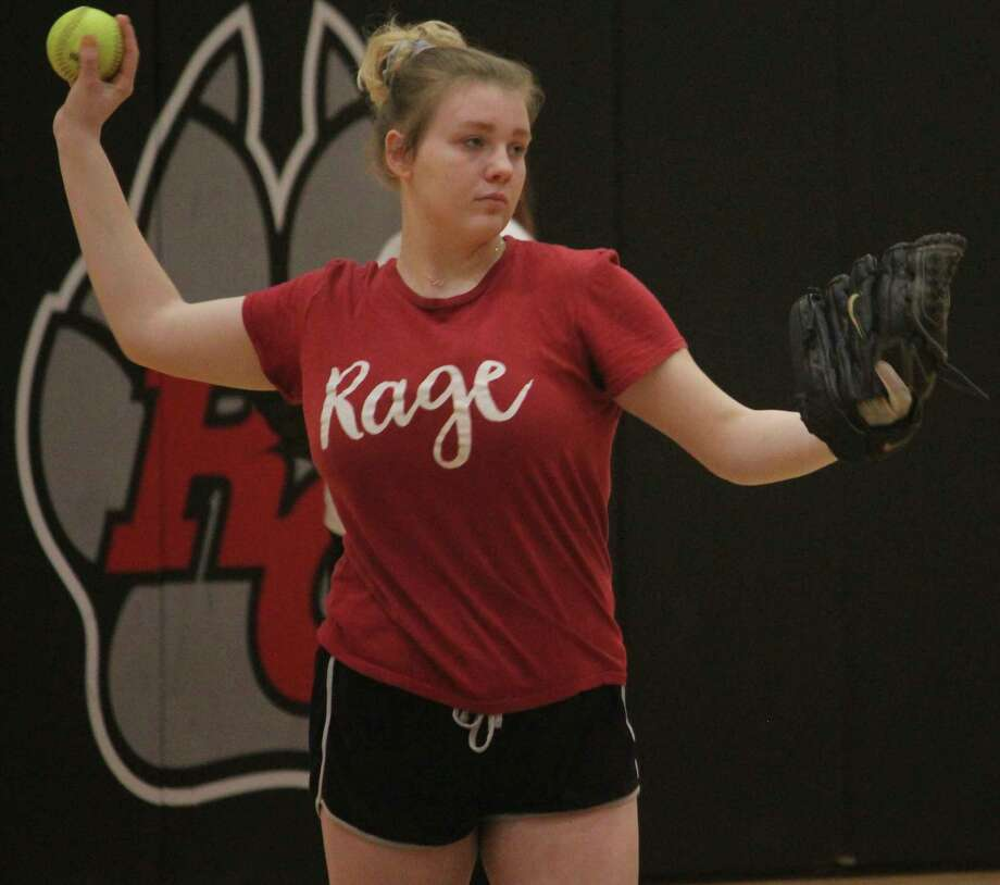 Reed City's Cassie Enos warms up her arm during a preseason practice. (Pioneer photo/John Raffel)