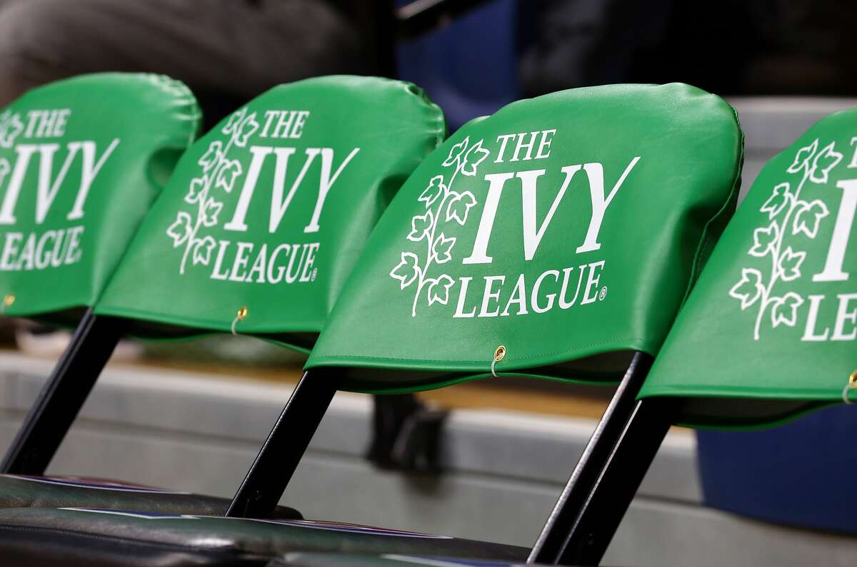 PHILADELPHIA, PA - MARCH 11: The Ivy League logo is displayed on chairs on the players bench during a game between the Princeton Tigers and the Pennsylvania Quakers at The Palestra during the semifinals of the Ivy League Basketball Tournament on March 11, 2017 in Philadelphia, Pennsylvania. Princeton won 72-64 in overtime. (Photo by Hunter Martin/Getty Images)