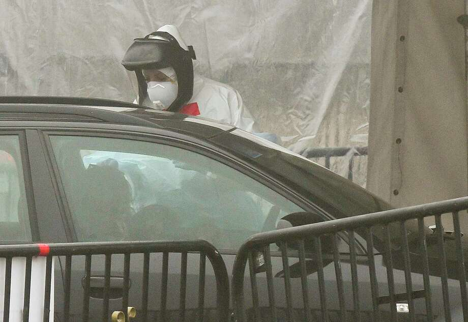 File photo of a person getting tested at a drive-thru COVID-19 testing site in Stamford, Conn., on March 20, 2020. Photo: Matthew Brown / Hearst Connecticut Media / Stamford Advocate