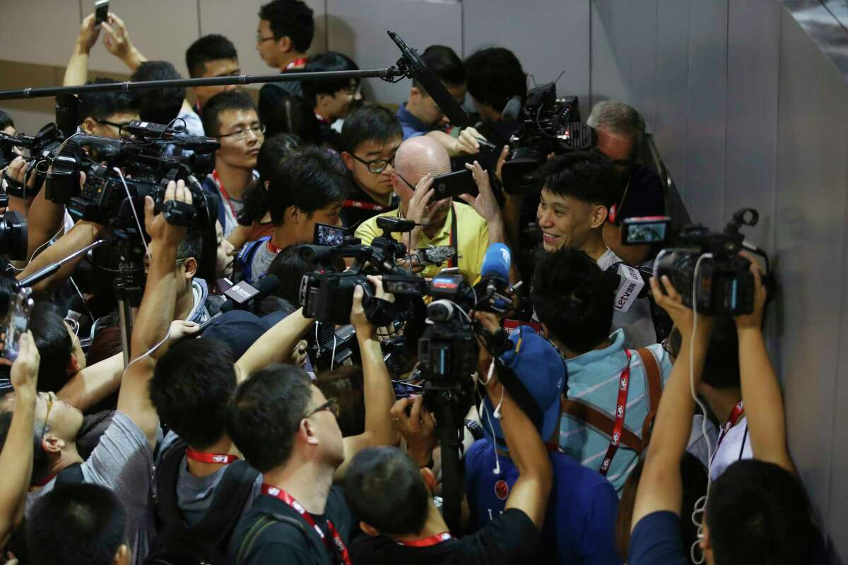 FILE - In this Oct. 10, 2015, file photo, NBA basketball player Jeremy Lin of the Charlotte Hornets talks to media after a training session for the 2015 NBA Global Games in Shenzhen, China. As sports prepare to resume, journalists are facing the same reckoning that their colleagues who cover politics, education and entertainment have encountered a€?