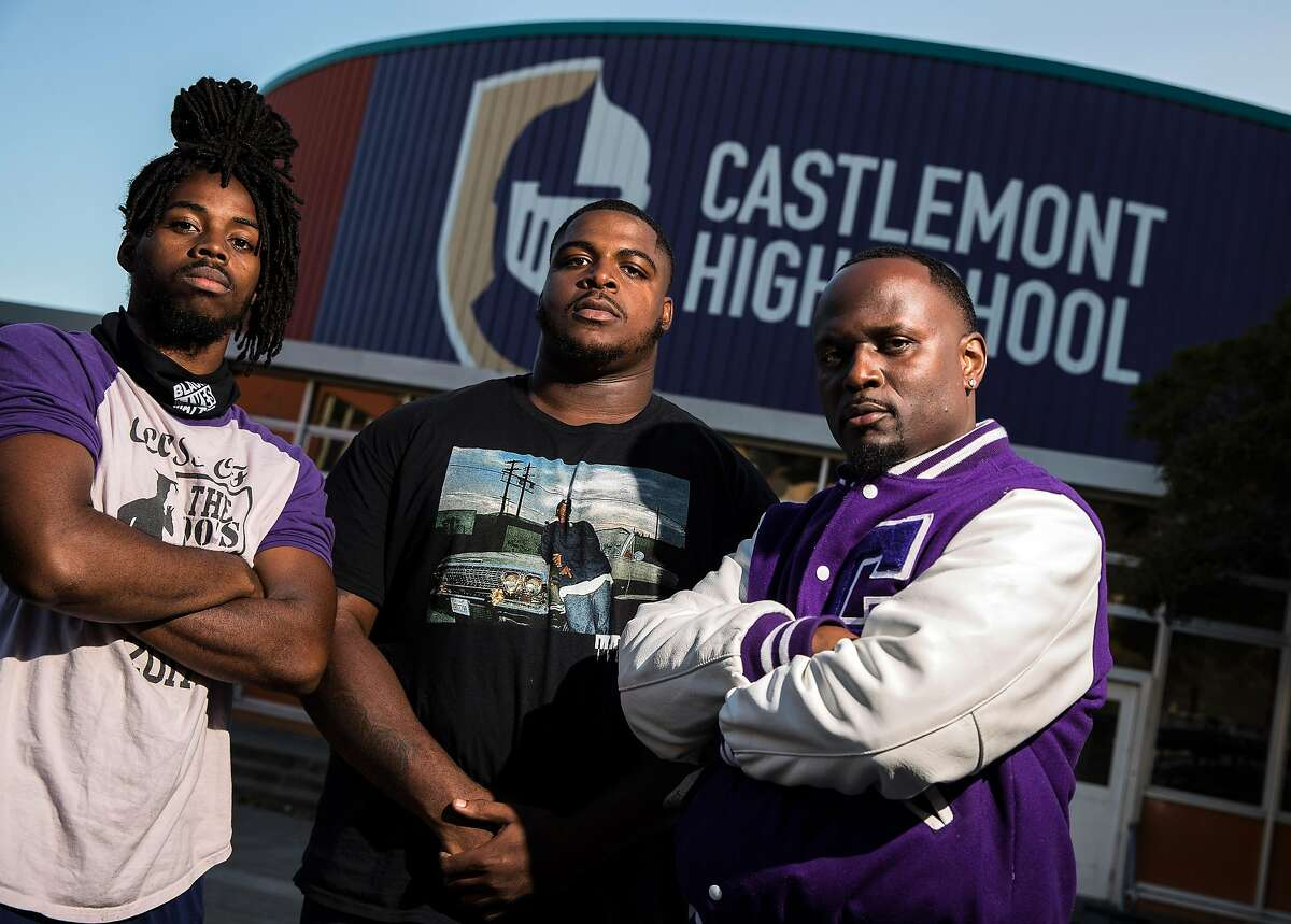 Coach Edward Washington, right, with players William Perkins, left, and Jadan Starks, center, (both �17) at Castlemont High School in Oakland, Calif., on Wednesday, July 1, 2020. In 2016, the team protested during the national anthem along with Kaepernick, the week after kneeling in a similar protest the week before.