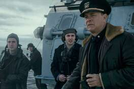 """Tom Hanks writes and stars in """"Greyhound"""" a fast-paced World War II picture about a U.S. destroyer captain in charge of a large convoy of ships crossing the Atlantic under the threat of a pack of Nazi U-boats."""