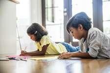 Children coloring on floor