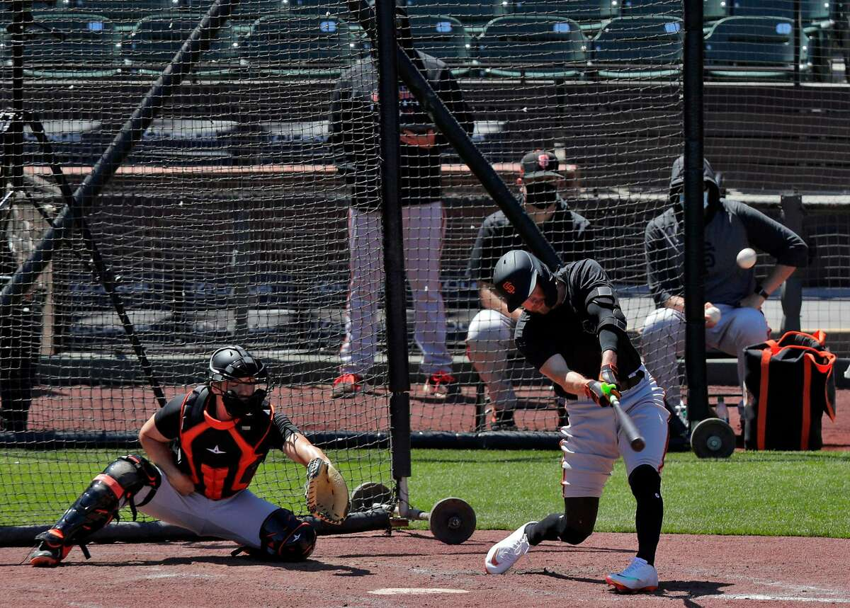 Hunter Pence (8) connects with a ball to deep left field As the San Francisco Giants worked out and played a simulated game at Oracle Park in San Francisco, Calif., on Wednesday, July 8, 2020.