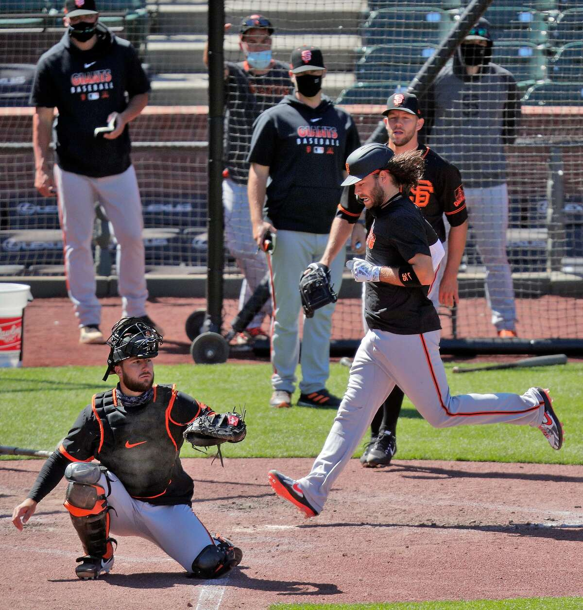Brandon Crawford (35) scores as the San Francisco Giants worked out and played a simulated game at Oracle Park in San Francisco, Calif., on Wednesday, July 8, 2020.