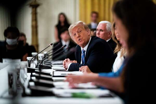 President Donald Trump, shown above at Tuesday's roundtable discussion on the Safe Reopening of America's Schools in the East Room at the White House, has taken a harsh tone in seeking a full reopening of schools.