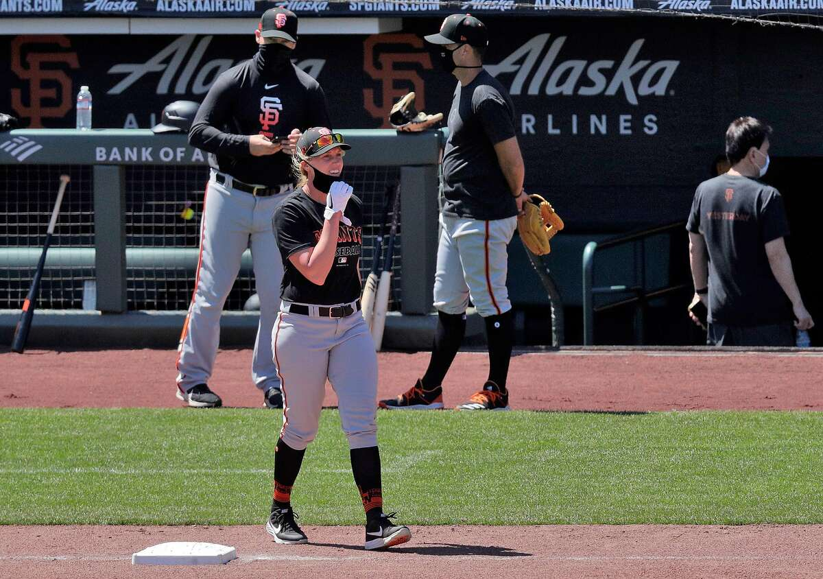 Alyssa Nakken walks toward the outfield as the San Francisco Giants worked out and played a simulated game at Oracle Park in San Francisco, Calif., on Wednesday, July 8, 2020.
