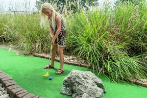Eight-year-old Alise Martin putts through one of the tunnel obstacles on the course. Colorado Canyon has undergone some improvements recently including new surfaces on many of their greens, and more will be replaced in the future. Photo made on July 5, 2020.  Fran Ruchalski/The Enterprise