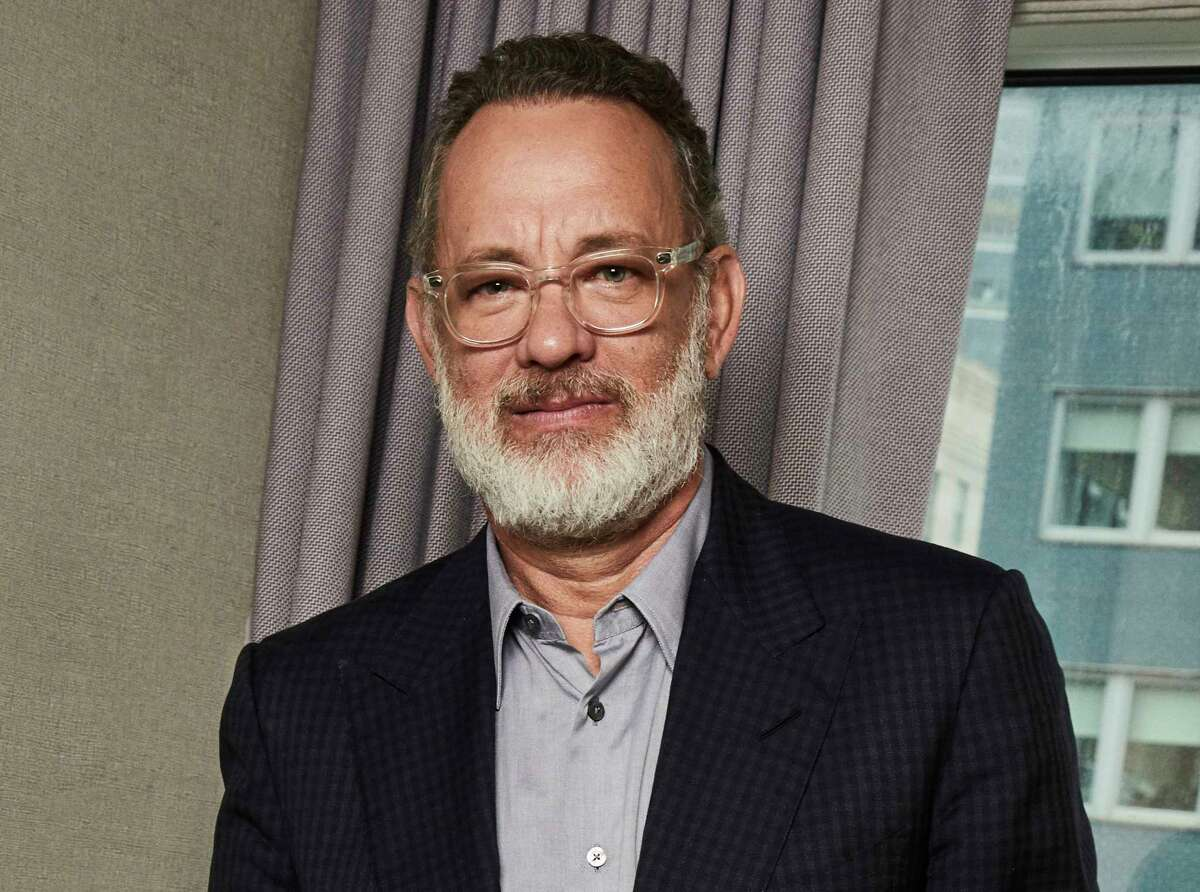 FILE - This Nov. 17, 2019 photo shows Tom Hanks posing for a portrait in New York. Hank's latest film