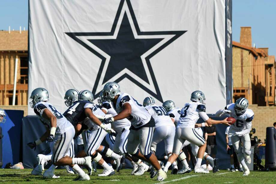 FILE - In this Monday, July 29, 2019, file photo, Dallas Cowboys practice at the NFL football team's training camp in Oxnard, Calif. The coronavirus pandemic forced the NFL to abandon, at least for 2020, the fading but still time-honored tradition of teams traveling to training camp. (AP Photo/Michael Owen Baker, File) Photo: Michael Owen Baker / Copyright 2019 The Associated Press. All rights reserved.