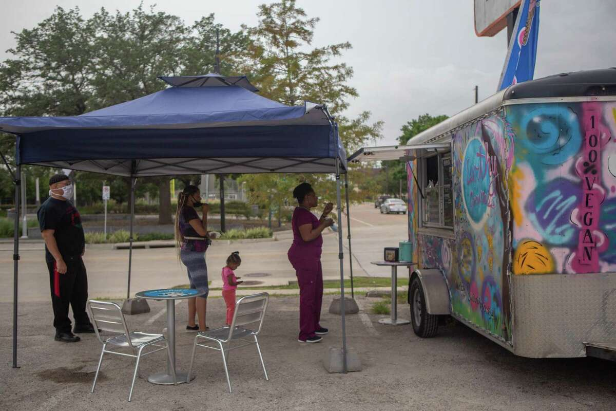 Houston - A line forms outside of the vegan ice cream truck, Earthy Goodness, on Black Out Day. Tuesday, July 7th was a designated day for Black people nationally to financially protest systemic racism by only spending money at Black-owned businesses (HC).