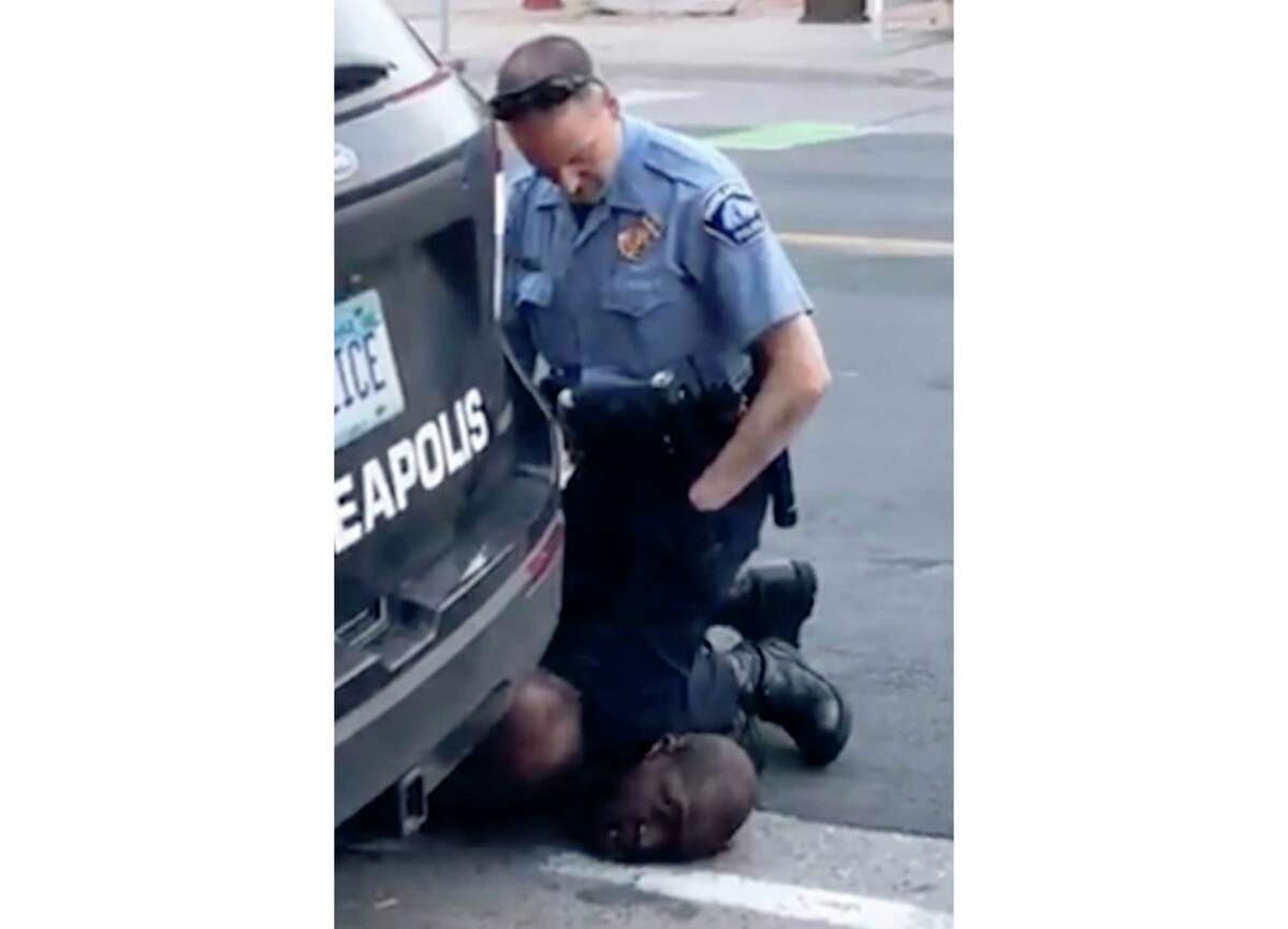 FILE - In this file frame from May 25, 2020, video provided by Darnella Frazier, a Minneapolis officer kneels on the neck of George Floyd, a handcuffed man who was pleading that he could not breathe. Floyd died after being restrained by Minneapolis police officers on May 25. (Darnella Frazier via AP, File)
